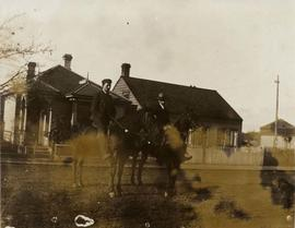 James McLearen Muirhead and Mr. Edgar Wade on horseback in front of 131 Quadra