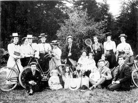 Group with bicycles and tennis racquets