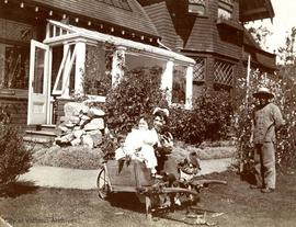 Mary Rattenbury, Nurse and Foy the gardener in the garden of 1701 Beach Drive