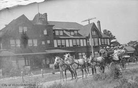 Robert Winter driving a sightseeing wagon by the Oak Bay Hotel