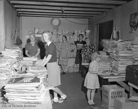 War effort, sorting newspapers and magazines for overseas