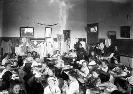 School interior, girls' sewing class