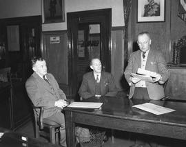 Mayor Percy E. George and City officials inside City Hall council chambers
