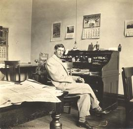 William D'Oyly Rochfort in his office in the Five Sisters Block