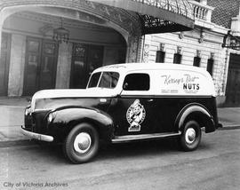 Kersey Nut Co. Delivery truck in front of the Royal Theatre
