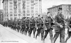 Western Scots, 4th platoon No. 3 Company marching in front of the Empress Hotel