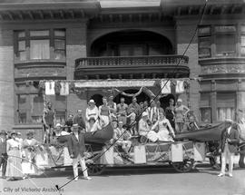 Vancouver Island Athletic Association (VIAA) float in front of Dr. Fraser's house on Broughton St...