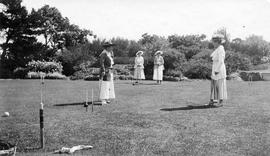 Maude Cridge, Lillian Macdonald, Flora Burns and Mrs. Tom Kier play croquet on lawn of 1290 Beach...