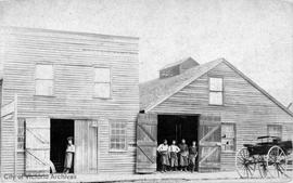 Meston's Carriage and blacksmith shop. Government Street at the Corner of Pandora Avenue, east side