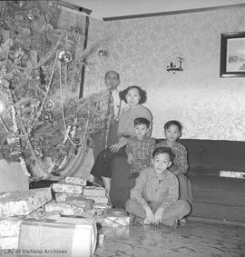 Chinese family by Christmas tree