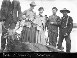 Agnes Deans Cameron and Jessie Brown and others with moose, Peace River, Alberta