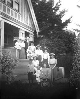 Bantly family outside their home at 1127 Fort Street. Johanna Bantly third from left with baby