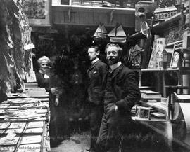Barber brothers, George W. and Walter W. and Mrs. Holdcroft (nee Barber) in their toy store at 12...