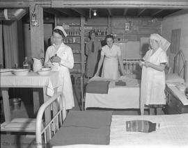 Nurses in an air raid shelter