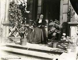 Mrs. W.H. Lowe on the porch of 1817 Quadra Street