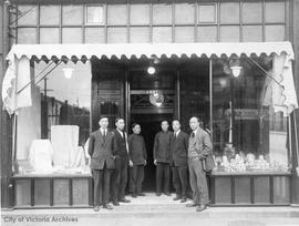 Group of employees outside store, 1501 Government Street