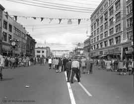 Yates Street during a parade looking west