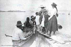 Children looking at salmon. Girl on far left is Dorothy Lawrie
