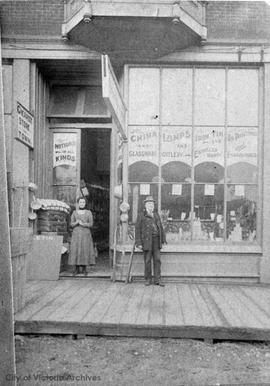 Raphael D. Davis outside his variety store at 621 Johnson Street