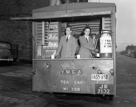 "YMCA Tea Car.  Mrs. Lionel Gibbs on right and Mrs. Robin Gurdon. During the Second World War, the mobile canteen, known as the ""Tea Car"", was introduced to supply food and drinks to troops, other war workers"