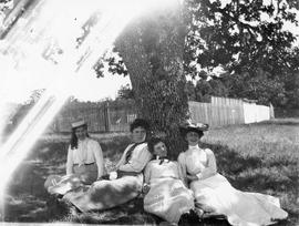 Four unidentified women under a tree
