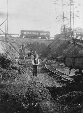 Construction of narrow gauge Canadian National Railway (C.N.R.) tracks going under Burnside Road