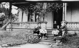 """Orchard House"", 633 Michigan Street. Jones family on the steps"