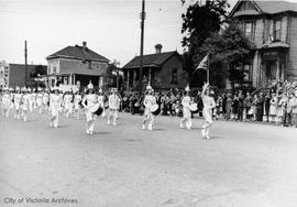 Victoria Girls Drill Team in a parade on Yates Street, between Quadra Street and Vancouver Street