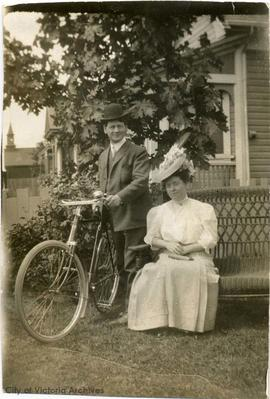 Mr. and Mrs. Cusack with bicycle