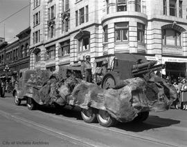 Military parade corner of Government and Humboldt Streets. Camouflaged truck mounting a 77-mm fie...