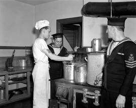 Sailors in a galley