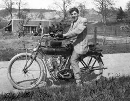 "Chellis ""Chic"" Galer on an Indian Motorcycle on Knight Road. Knight Nursery in the back..."