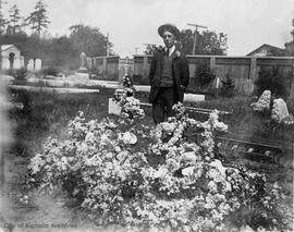 Richard Muirhead beside family grave in Ross Bay Cemetery