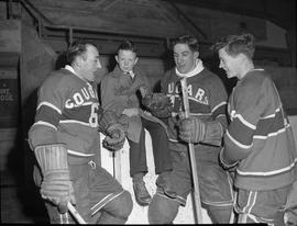 Victoria Cougars players with boy in trench coat