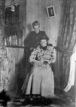 Agnes Deans Cameron and Jessie Brown inside Hudson's Bay Company house at Fort Vermillion