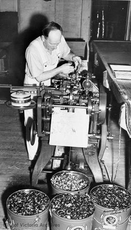 Arthur Armstrong working the candy machinery at Ormond's biscuit factory