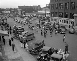 Youth group parade. Looking north on Blanshard Street from Yates Street.  Parade on its way to Beacon Hill Park