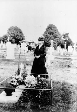 Woman beside grave