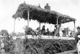 Parade float decorated for the broom carnival in front of Grahame residence 818 Hillside Avenue (...
