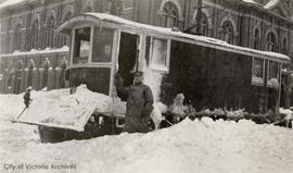 Douglas Street, Streetcar and City Hall in background during the 'Great Snow'