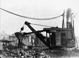 Steam shovel digging a trench to bury conduit, probably Telegraph Street