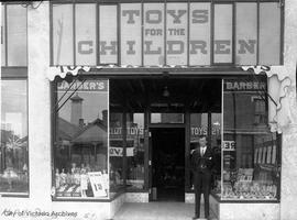 "Gordon Holdcroft outside the family business ""Barber's Toys for the Children"""