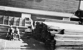 Unidentified men in a lumberyard