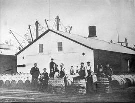 M.L. Sweeney and crew inspecting 5000 barrels of whale oil for Pacific Whaling Company, outer docks