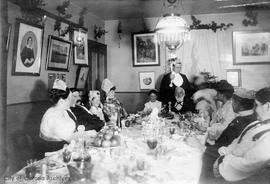 Christmas at Helmcken house, 638 Elliot Street: L to R: Rita McTavish, E.E. Harris, Harry Helmcke...