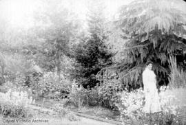 "Edith Louisa Helmcken ""Aunt Dolly"" in Helmcken garden, now site of Thunderbird Park"