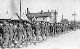 Troops marching on Quadra Street looking north east from south of Fort Street