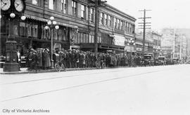 Line-up for hockey tickets for the Victoria Cougars vs. the Edmonton Eskimos, Government Street