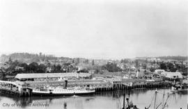 "Black Ball ferry ""Sol Duc"" at the Canadian Pacific Railway (CPR) docks and view over Ja..."