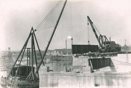 Johnson Street Bridge under construction, placing girder